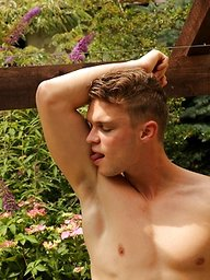 Hard bodied Justin Lovers strokes his cock outdoors.